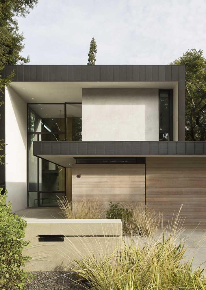 Fachada de casa de campo moderna em tons de branco e preto