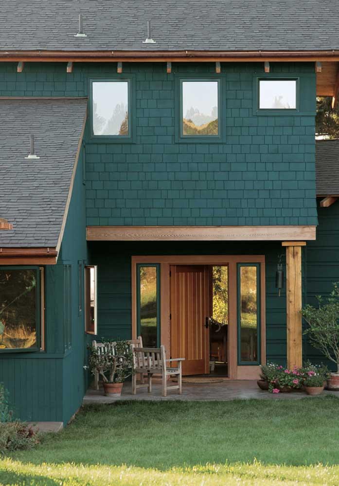 Casa de campo com paleta de cores que remetem a natureza