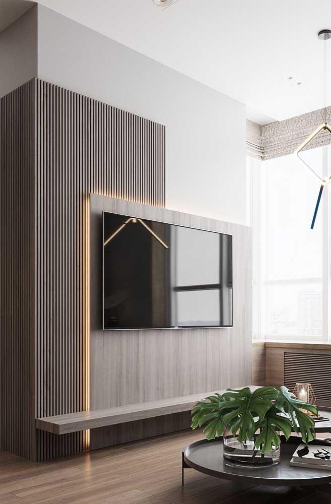 Papel de parede pode ser uma ótima opção de decoração para sala de TV.