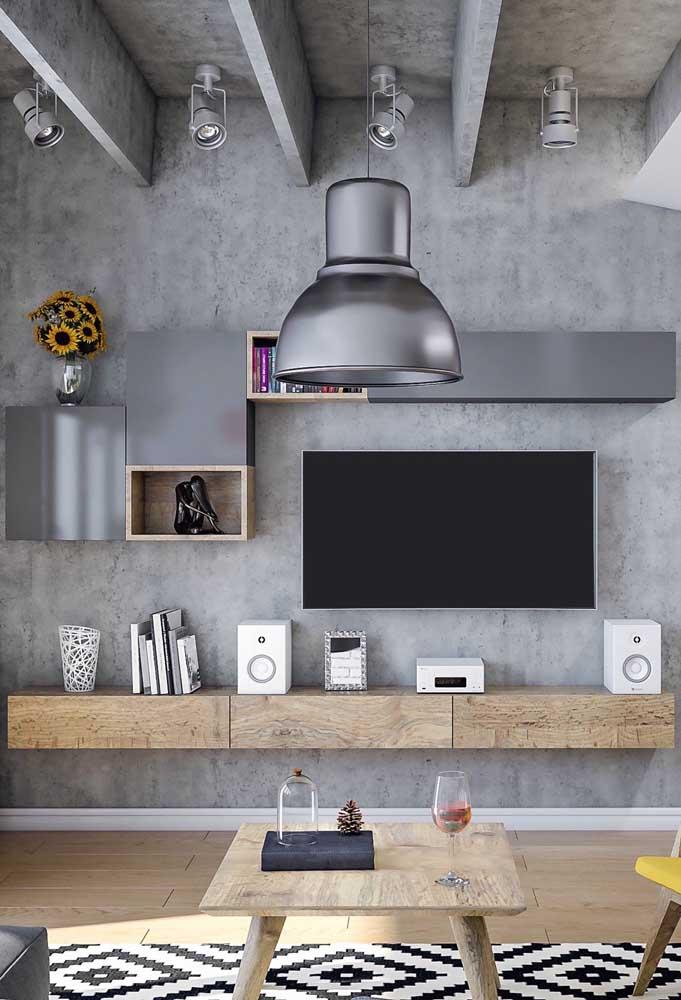 Você pode decorar a sala de TV seguindo o estilo industrial.