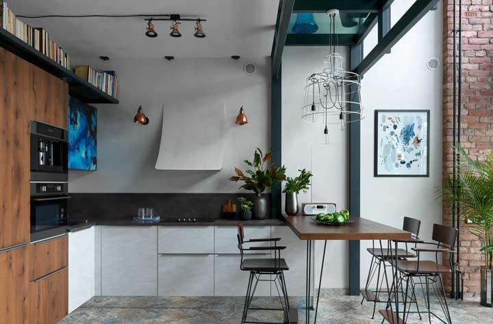 Mesmo com a sala de jantar sendo conjugada com a cozinha não pode faltar o lustre que combine com o espaço.