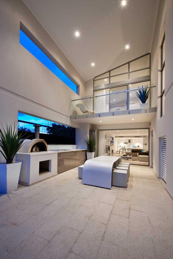 Área gourmet pequena integrada com a parte de dentro da casa