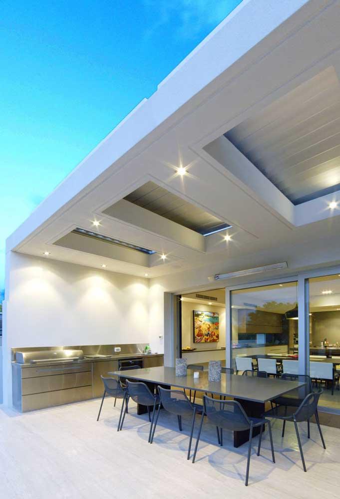 Área gourmet pequena moderna e com uma iluminação perfeita para o dia ou para a noite