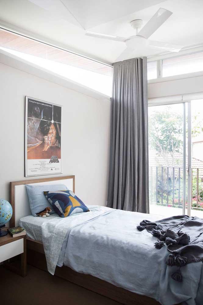 Um bom lugar para o seu quadro vintage: na cabeceira da cama