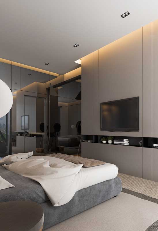 Quarto de casal de luxo moderno com painel para acomodar a TV