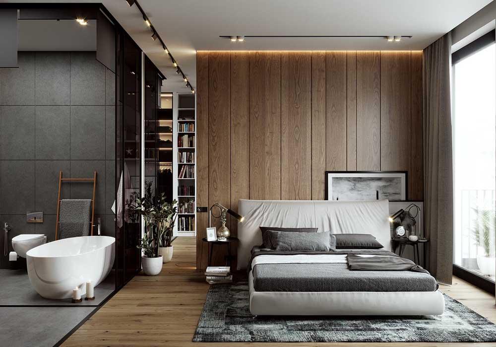 Um quarto de casal de luxo gigante com direito a closet e banheira