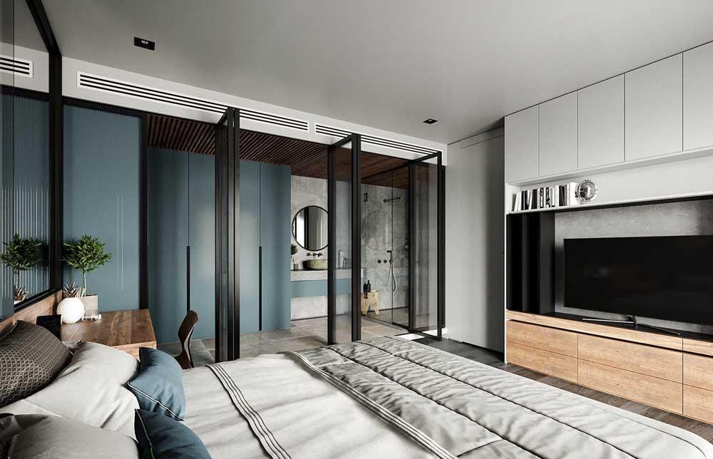 Aqui, closet e suíte foram integrados e podem ser acessados pela mesma porta de vidro que os une ao quarto