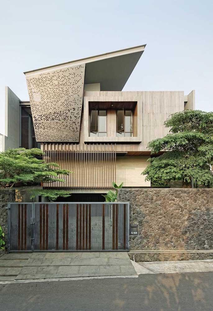 Frente de casa moderna com destaque para o mix de materiais que compõe a fachada