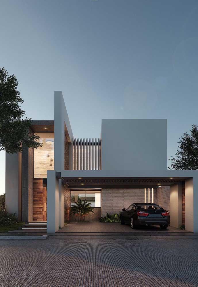 Fachada de casa sobrado moderna com garagem e platibanda