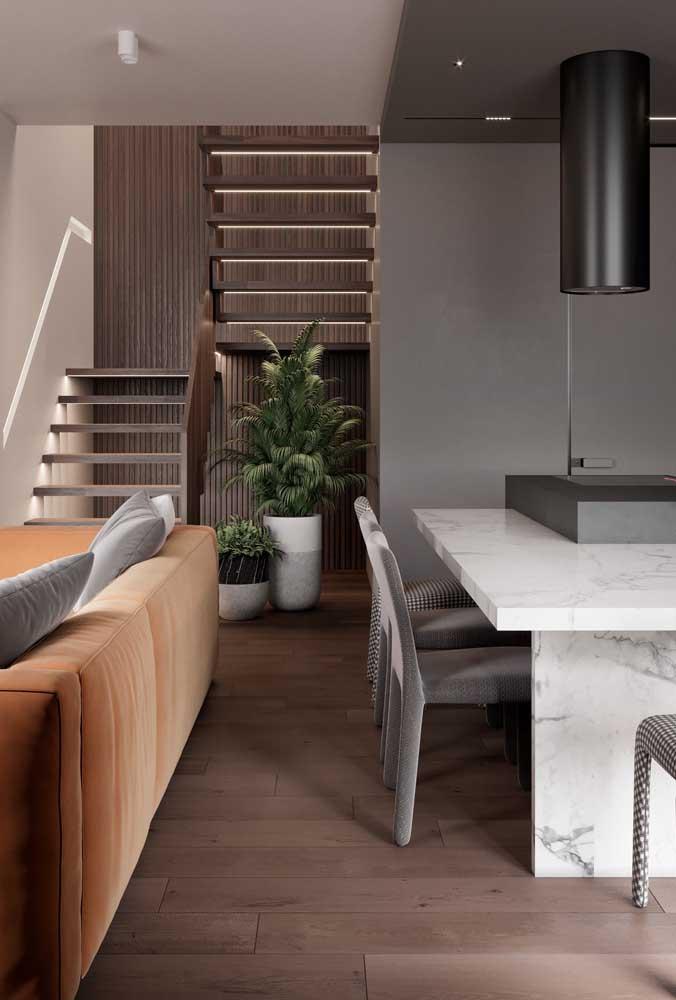 Casa moderna vista por dentro com sala de estar e jantar integradas