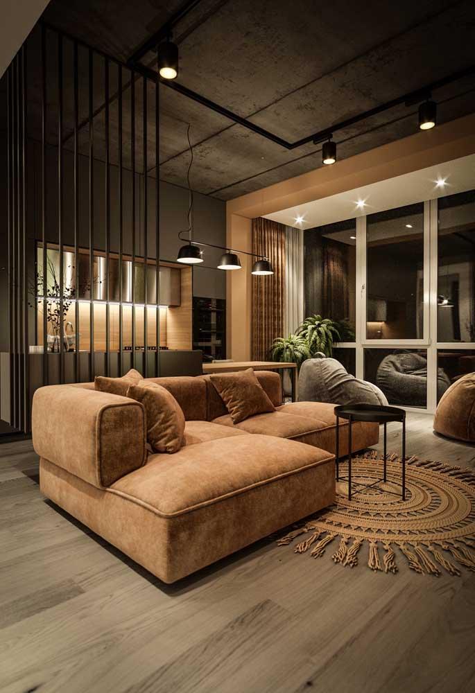 Cozinha planejada para apartamento pequeno integrada com a sala de estar pelas cores