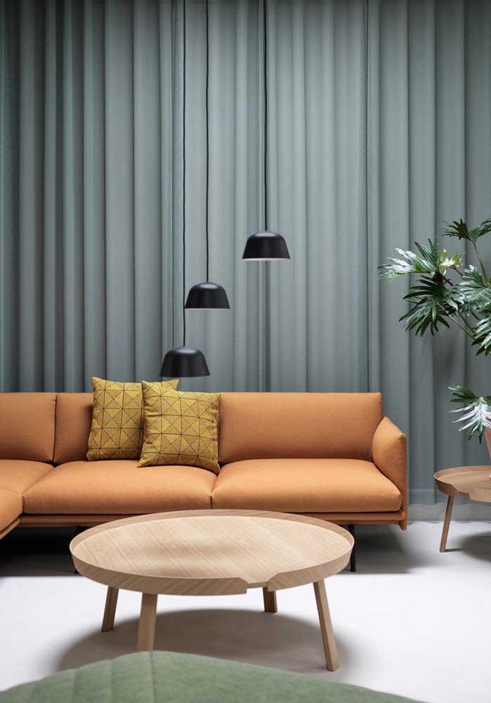 Luminárias pendentes sobre o sofá: perfeitas para o momento de leitura