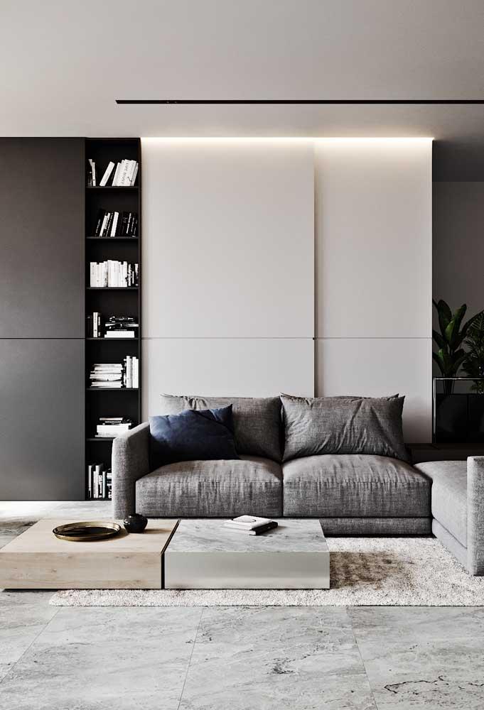 Nichos pretos na vertical em equilíbrio com os móveis branco e cinza
