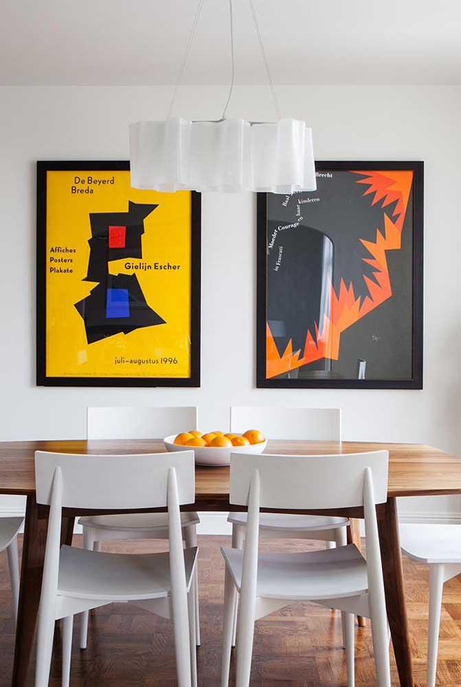 Não sabe como usar cores na sala de jantar? Aposte nos quadros!