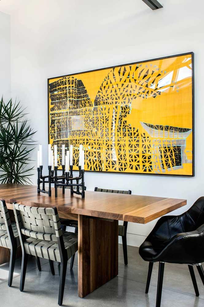 Você também pode optar por escolher um quadro que acompanhe o tamanho da mesa de jantar