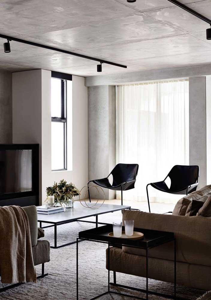 Sala decorada moderna com influência do estilo industrial