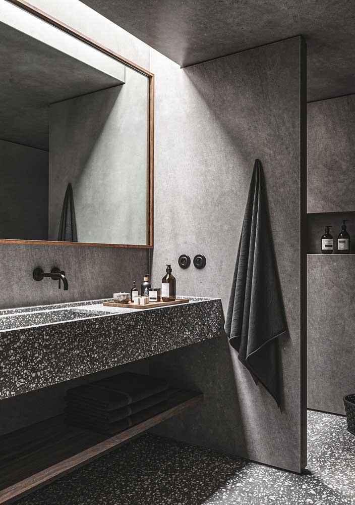 Banheiro cinza em todos os detalhes em um projeto moderno, sóbrio e sofisticado