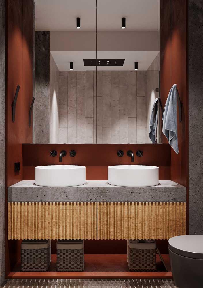 Banheiro terracota combinando com a luz fria da bancada