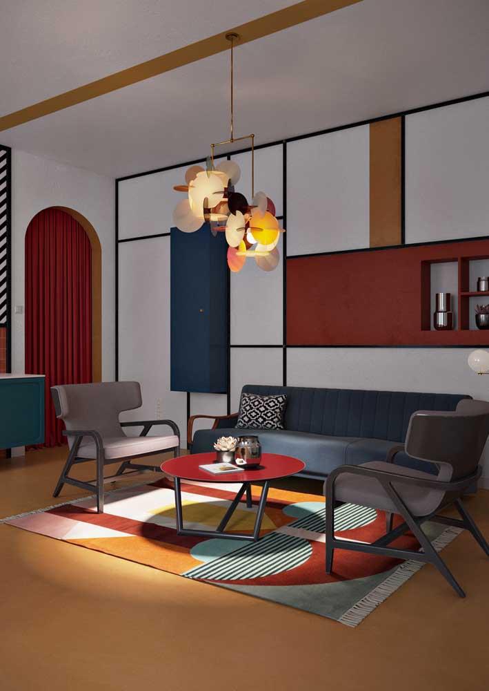 O lustre sempre deve acompanhar o estilo da sala. Esse aqui, por exemplo, é tão conceitual quanto o restante da decoração
